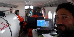 Josh Cutler inside the NOAA Twin Otter survey plane